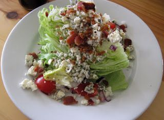Outback's Blue Cheese Wedge Salad minus the bleu cheese add extra bals sauce :)