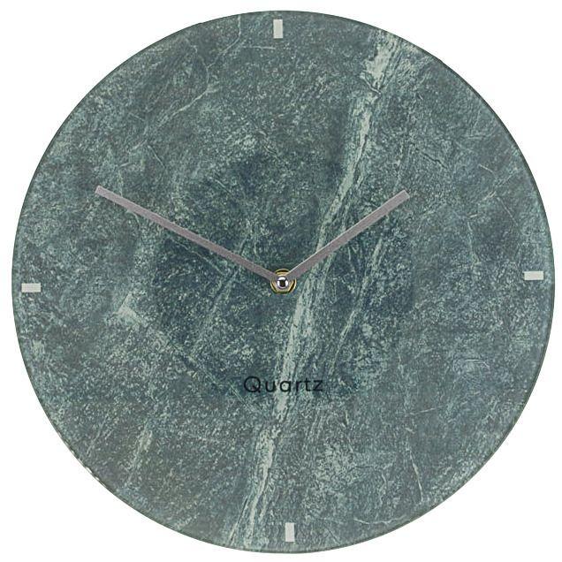 Klasyczny zegar ścienny wykonany ze szkła imitującego marmur. Bardzo oryginalny design. Wyposażony w system QUARTZ oraz dwie wskazówki do odmierzania godzin i minut. Ø 30 cm