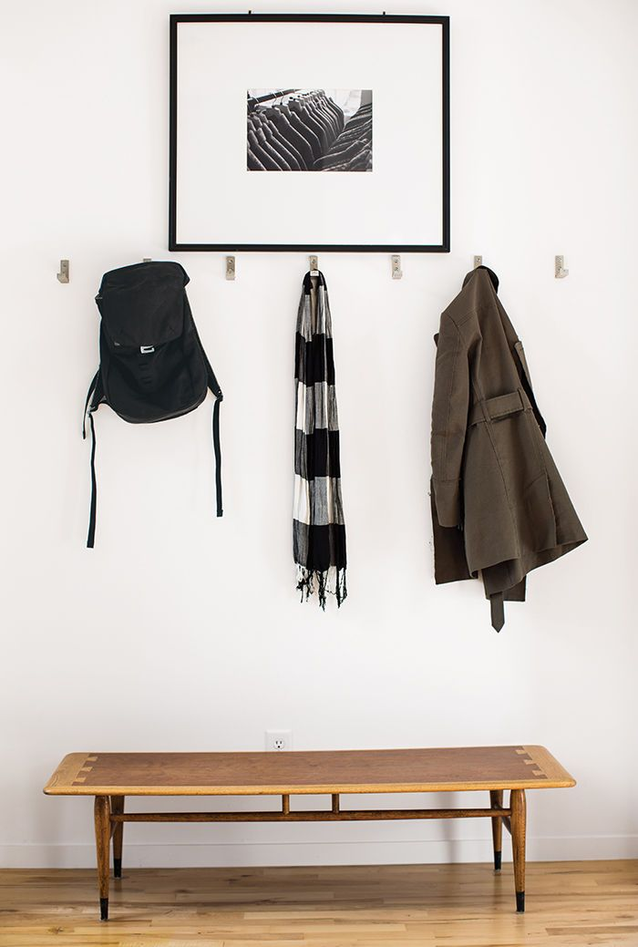 Affordable Kansas City Home Entrance With Aluminum Ikea Hooks And Vintage Coffee Table