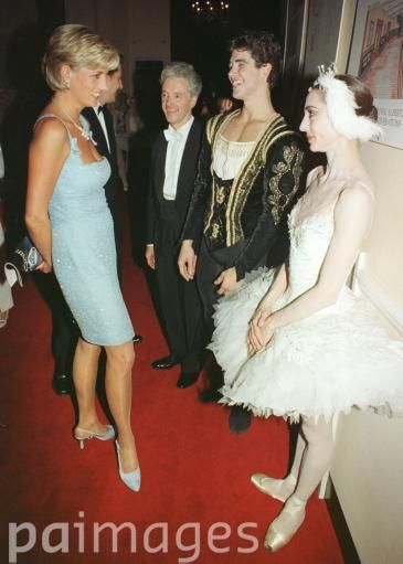 DIANA, PRINCESS OF WALES DISCUSSES THE PERFORMANCE OF SWAN LAKE WITH PRINCIPLE DANCERS ROBERTO BOLLE AND ALTYYNAI ASYLMMURATOVA AT THE ROYAL ALBERT HALL