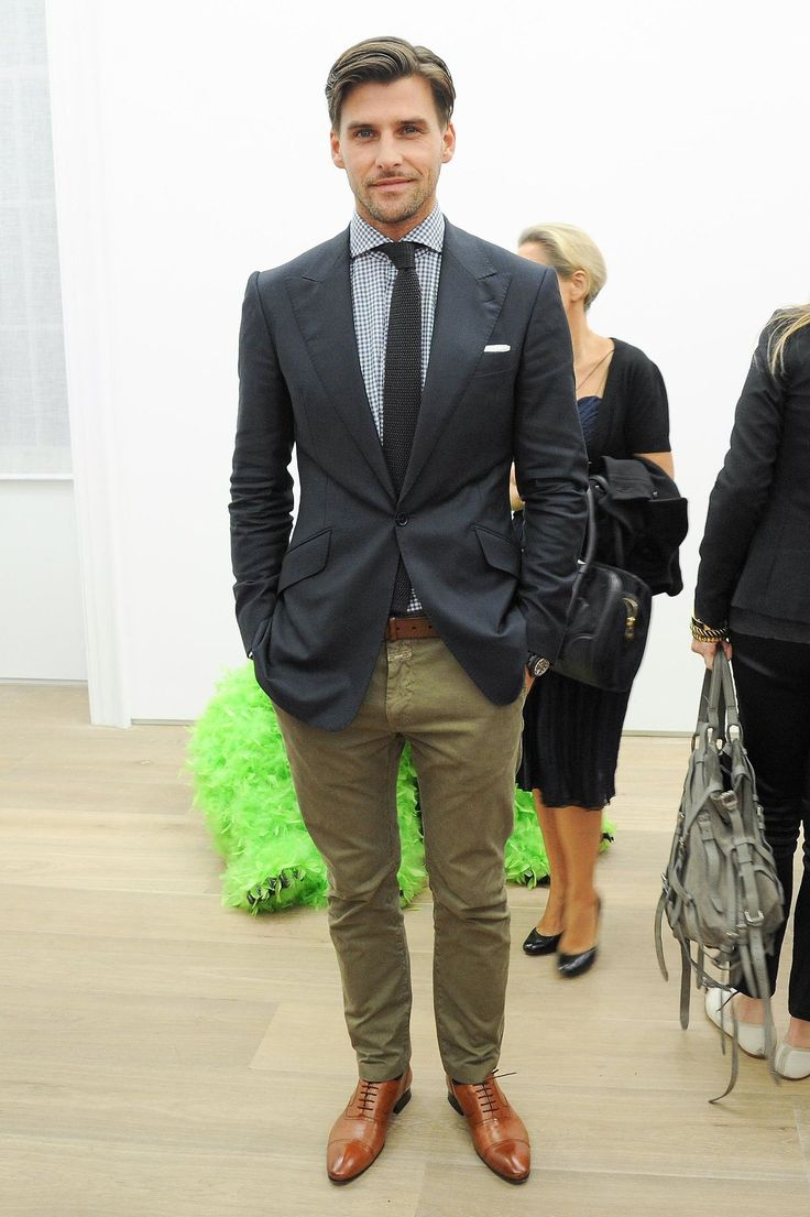 Dark grey jacket, black gingham shirt, dark grey knit tie, olive pants