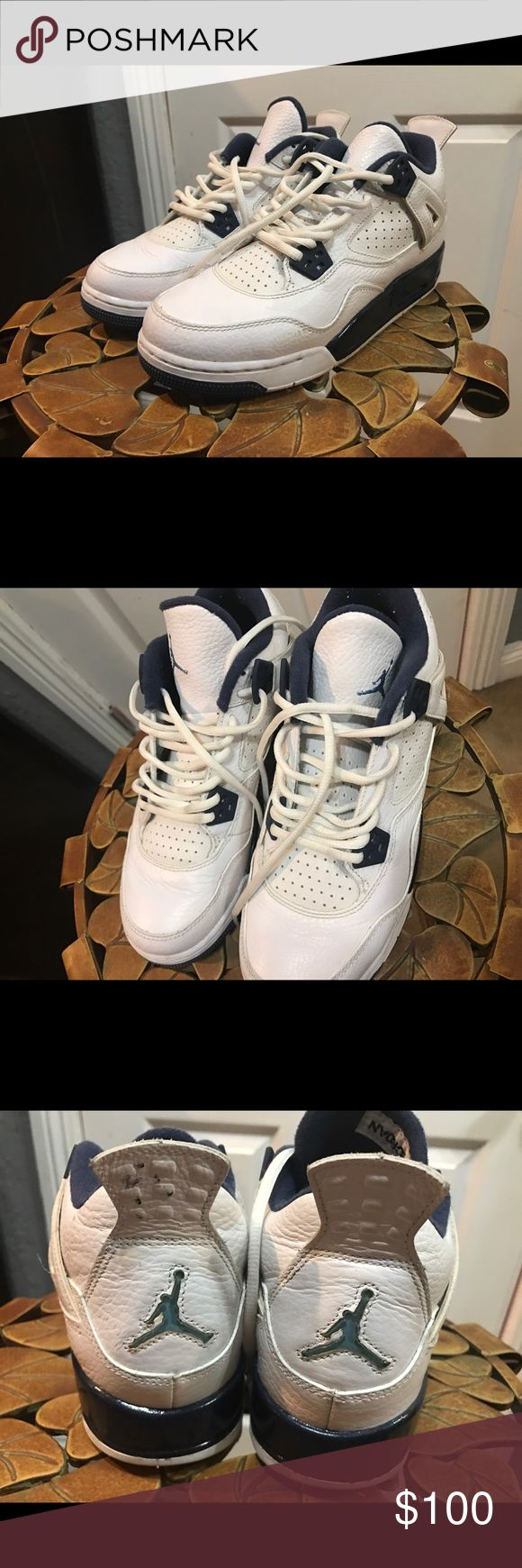 Blue and white Jordan's Kids size Midnight blue/navy & White Jordan 4s. Worn a few times, but still I'm really good condition, just needs a little cleaning. Can be worn women's size 7.5/8. Jordan Shoes Sneakers
