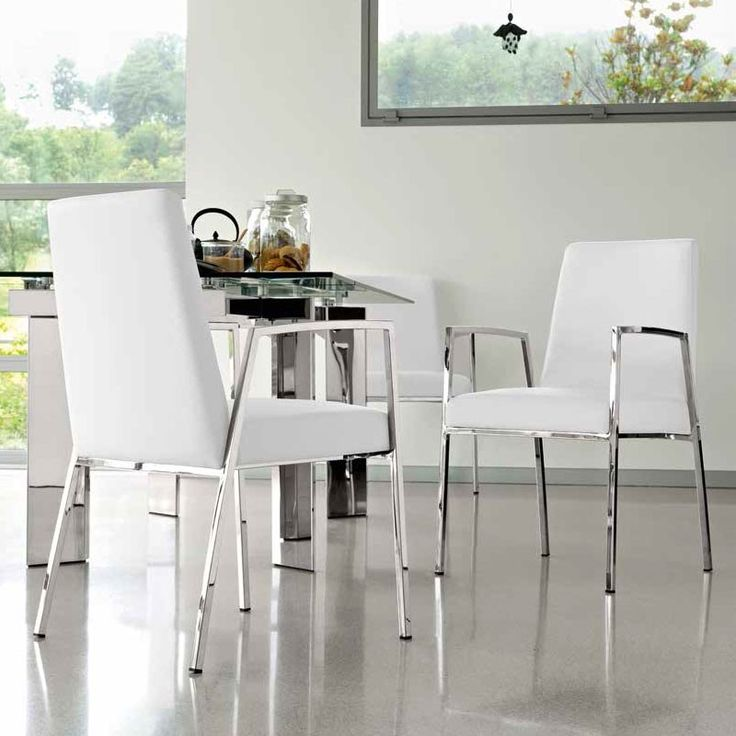 modern upholstered dining chair in faux leather or real leather and a padded seat for extra comfort