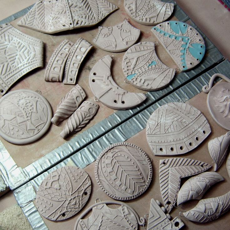 BHClaysmith: SNOW Plaquettes, named for the time I was granted to get involved in making them... These pendants and earring beads were impressed on both sides with patterning from my Intaglio mats (available on Etsy).  The shape was determined by these patterns!