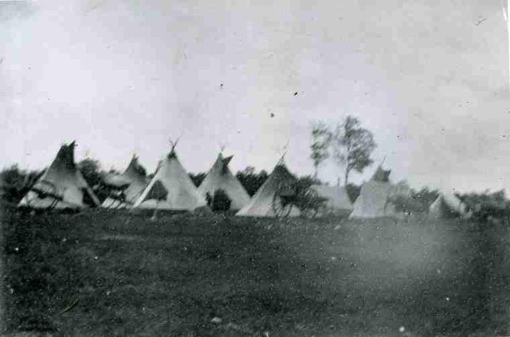 An Aboriginal camp near Yorkton, Saskatchewan. Several Red River Carts are in evidence.