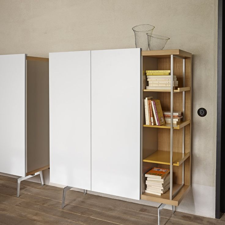MIXTE 'Living'. Shown as 'High board' storage. W 121 x D 47 x H 147 cm.From £2758.00. This interesting mix of cupboard and open storage can be ordered left or right and with a choice of 3 stains of sawn oak for the main frame and/or doors and 4 lacquers for other elements. Feet in chrome or argile lacquer.