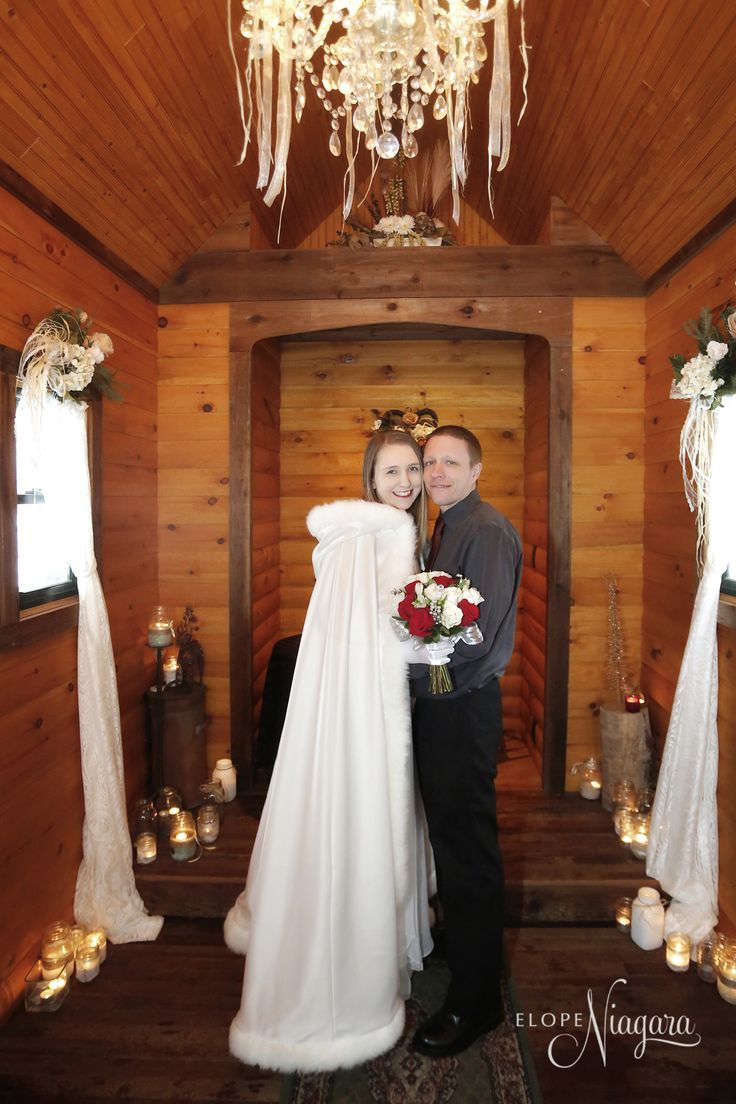 A gorgeous winter wedding cape perfect inside our charming and cozy Little Log Wedding Chapel- perfect for a romantic elopement