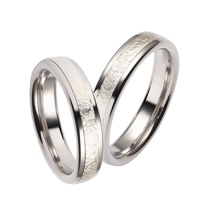 Price starts from 719$ to 1350$ White Gold Wedding Band. Available in 14K, 18K and in Platinum. The band has 1 diamond in the center, total carat 0.02 ct.  The clarity of the diamond is SI and the color is H.  The width is 5mm and the gold weight starts approx. from 11 g.