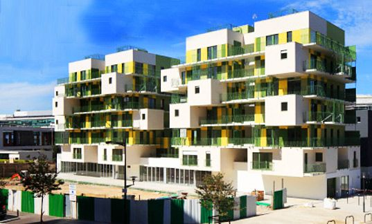 28 colorful and airy social housing units in Courbevoie, France - a compact housing solution that still allows occupants to feel a sense of ownership, individuality and escape from the hectic city. These bright apartments offer a rainwater collection system, a green roof and loggias for residents to use as their own private greenhouse.