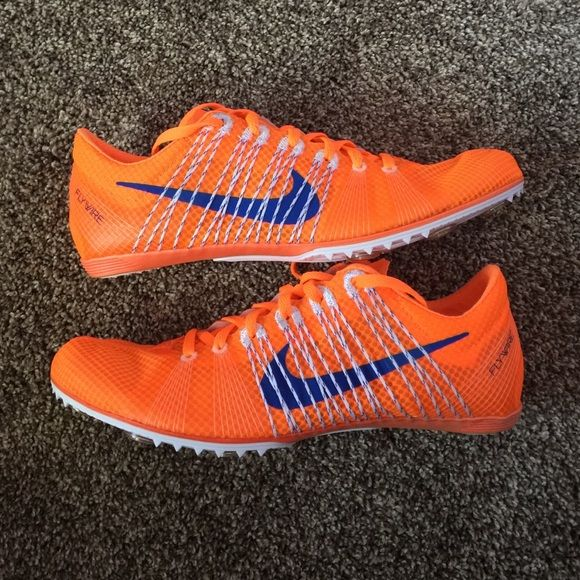 Nike Zoom Victory 2 racing spikes Brand new. Never worn and still in box.  Zoom Victory 2 track racing spikes. Bright orange with blue Nike swoosh.