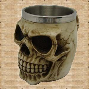 A skull with an evil smile covers this tankard and the handle has the appearance of spine bones. This skull tankard has a removable stainless steel insert for ease of cleaning measuring approximately 9.5cms deep with a diameter of 8cms. The Grinning Skull Tankard brought to the Skulls and Dragons drinkware range by Nemesis Now.    Height : 12 cm    Width : 10 cm    Length : 16 cm    Weight : 650.00g    Made from resin, stainless steel    Ref : SDNEM3933   Was £14.99 Now Only £7.50