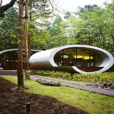 Shell House  The reinforced concrete exterior of this home, designed by Tokyo firm ARTechnic, mimics the organic curves of a shell. The soft arcs of the façade are echoed indoors. Though inspired by a shell, the rounded walls of the interior and exterior evince a futuristic twist that goes beyond nature.