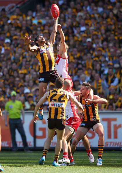 Cyril Rioli Cyril Rioli of the Hawks flies for a mark during the 2014 AFL Grand Final match between the Sydney Swans and the Hawthorn Hawks at Melbourne Cricket Ground on September 27, 2014 in Melbourne, Australia.