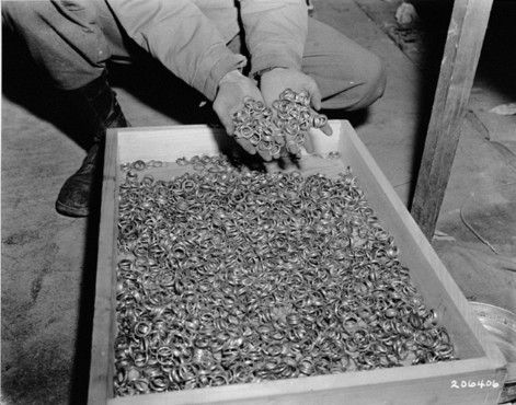 photos hundreds of wedding rings that were removed from those in Concentration Camps