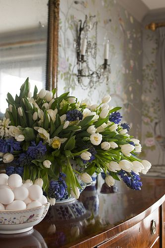 I love the white tulips with blue hyacinths. They are very elegant looking!  Flowers make me happy!