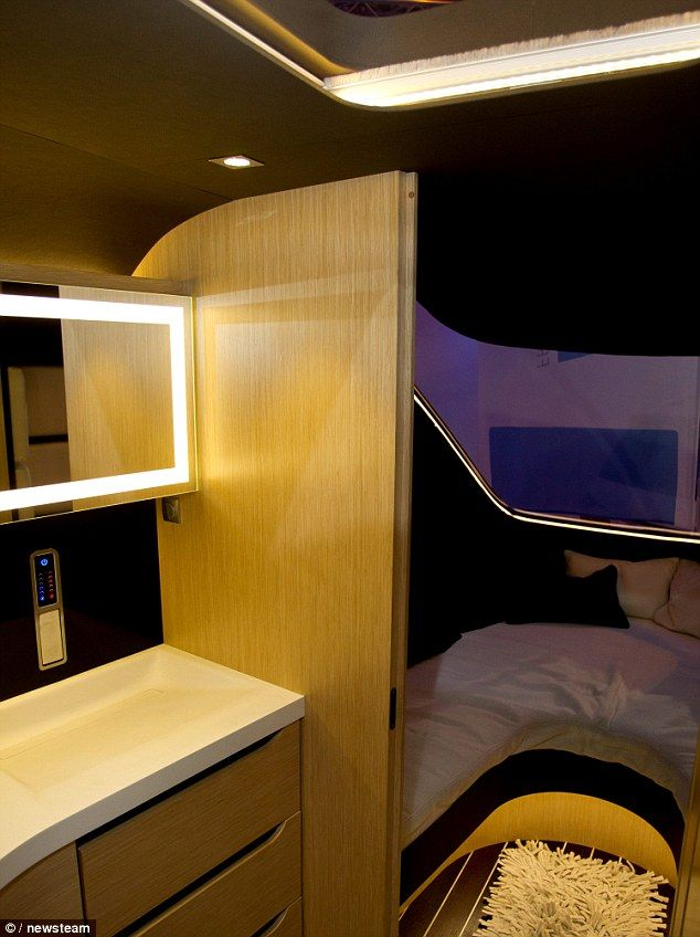 In good weather, the back of the caravan can be opened up to form an outdoor terrace with seating area