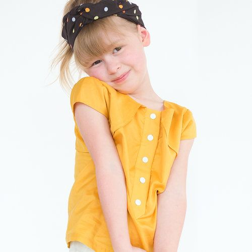 Girls indie top sewing pattern for kids named Powder Puff. Girls pdf pattern sewn in yellow silk with snap domes.