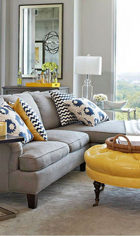 Grey Couch Yellow Ottoman With Navy Cream And Accent Pillow