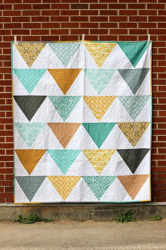 Turn your wall into a piece of art when you make and hang up the Fat Quarter Flagged Quilt Pattern. This quilt pattern really experiments with shapes and textures and you can make it with patterned fat quarters.
