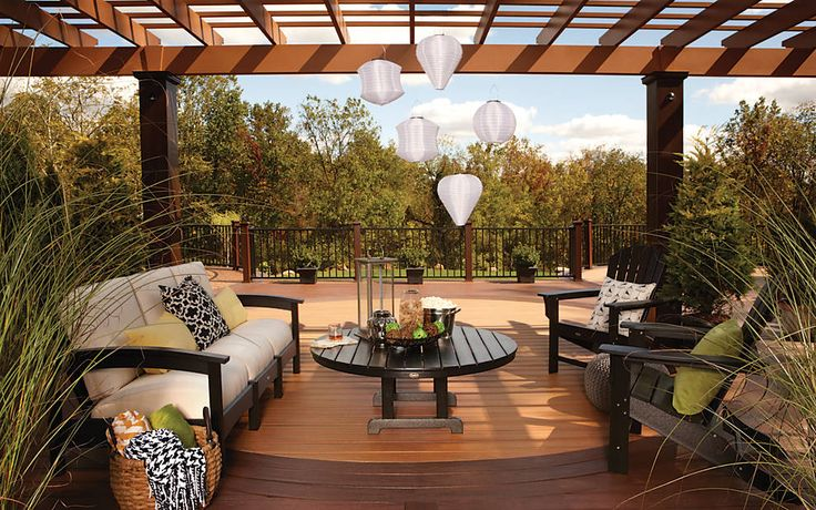 Create a space you'll never want to leave with classic decking combination, like #Trex Transcend #decking in Tiki Torch and Spiced Rum. Top off the deck with a pergola and Trex Outdoor Furniture Rockport club sofa and Adirondack chairs in Vintage Lantern.
