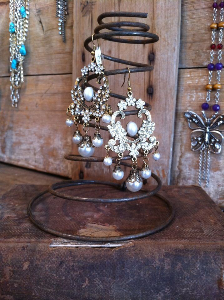 I love using old bed springs for jewelry displays!