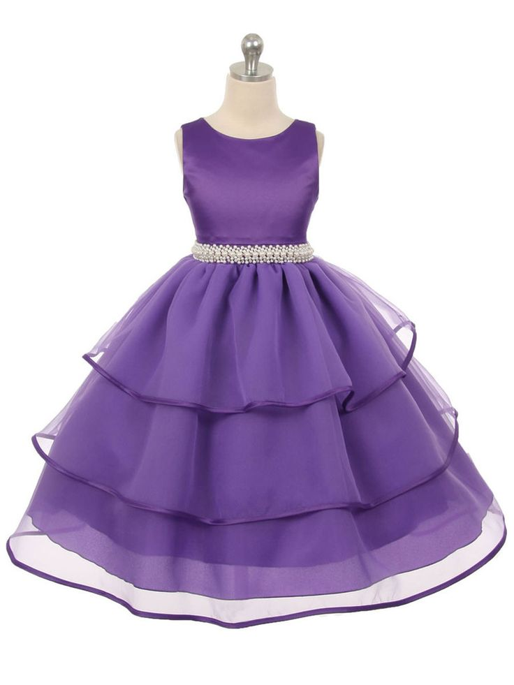 This dreamy dress is perfect for any little princess. The sweet organza layers will sway beautifully as she moves and the full lining assures she'll stay comfortable through the day. The waist is acce