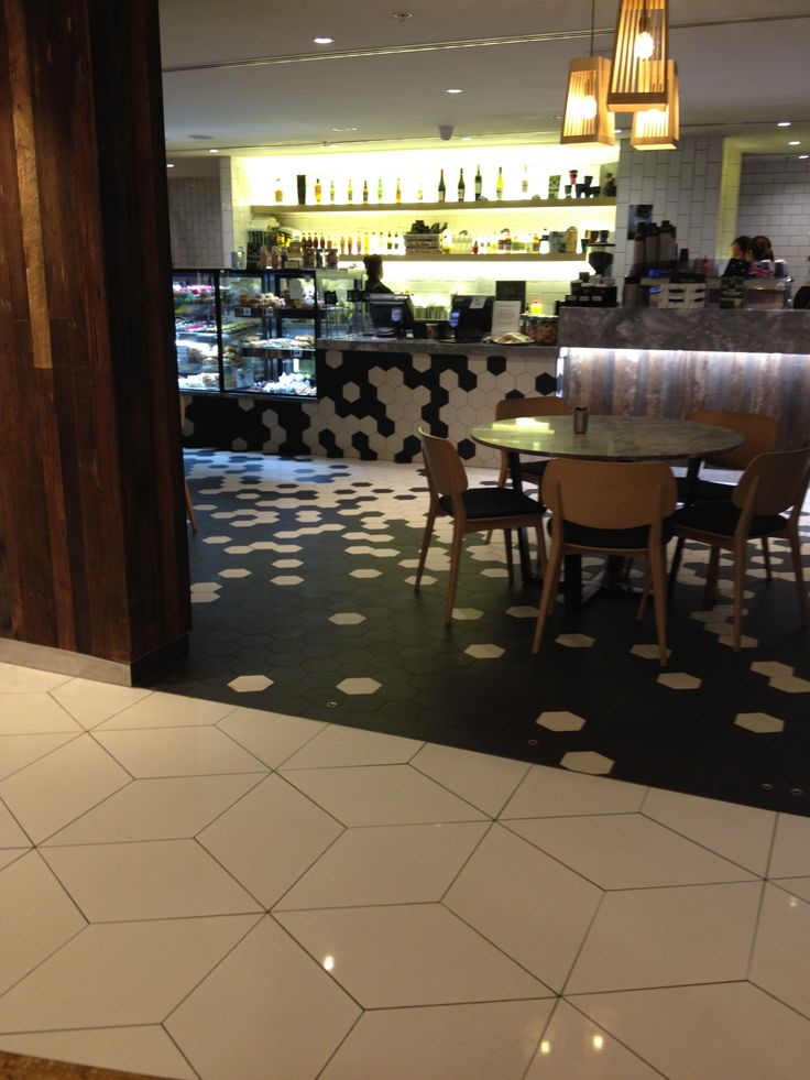 PHOTO 7: The design and placement of the hexagonal tiles is fun and draws the observer's line of sight to the food display at Degani.