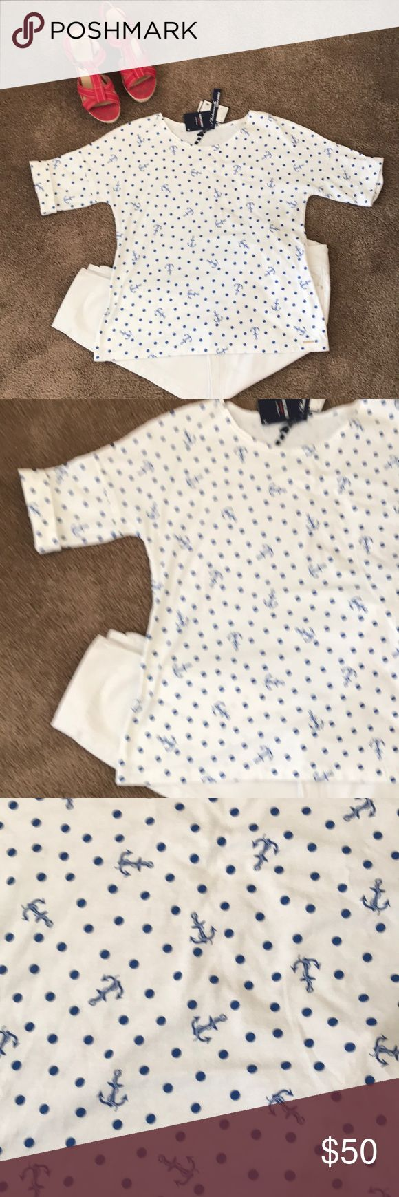 NWT Saint James blue polka dot top size 8 NWT- Saint James white short sleeve top with blue anchors and polka dots. 100% cotton. Size 8 ( fits like a medium ). Love this nautical look with white paints and heels or shorts and sandals. Perfect condition. Saint James Tops Tees - Short Sleeve