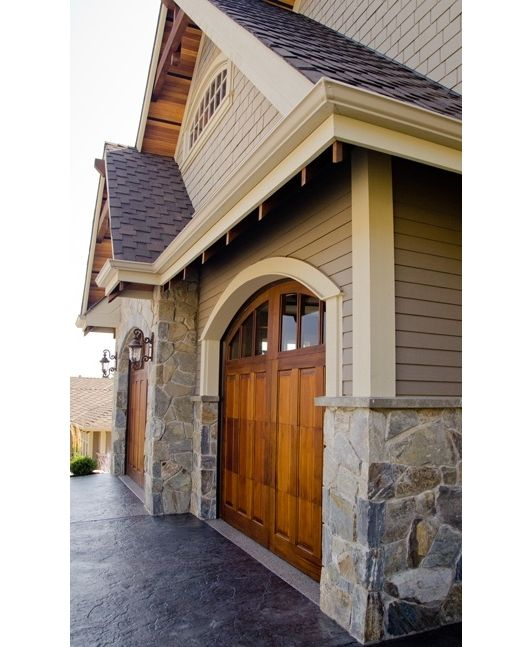Love the garage doors and the stone!