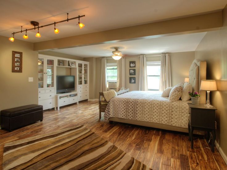 hand scraped hardwood flooring adds a touch of rustic charm to the rooms elegant design