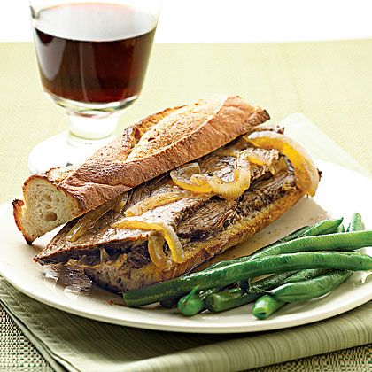 For these roast beef French dip sandwiches, slow-cook rump roast and serve over toasted French bread and top with the juicy onion sauce.