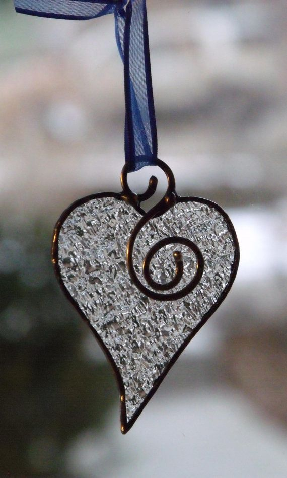 Heart Pendant - This pleasing little heart was cut from clear heavily textured glass that brings to mind the kind of ice created by brutal wind and freezing rain.