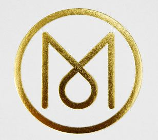 Monocle logo gold foiled