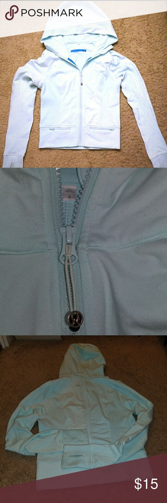 Lululemon Baby Blue Zip Up Hoodie Size 4 XS Gently used lululemon zip up hoodie with thumb holes and 2 zippered front pockets. slight fading from washes and sun, and slight discoloration from usage on wrist as shown in last picture. Still a wonderful and comfy cute hoodie! measure about 20.5 inches from shoulder to bottom, great to layer tank top and leggings! lululemon athletica Tops Sweatshirts & Hoodies