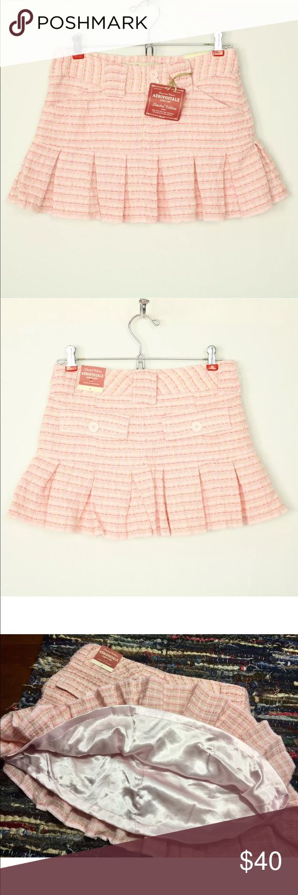 "Aeropostale Skirt Mini Limited Edition 0 Pink Aeropostale Skirt Mini Limited Edition Size 0 Pink White Tan Pleated  NEW WITH TAGS!! AEROPOSTALE LIMITED EDITION PLEATED MINI SKIRT SIZE:  0 COLOR:  PINK, WHITE, TAN Skirt is lined Front pockets Back button flap pockets Belt loops **SEE MEASUREMENTS BELOW**  APPROXIMATE MEASUREMENTS FLAT ACROSS:  WAIST (MEASURED ACROSS THE TOP EDGE):  13 1/2""  HIPS:  17""  WAIST TO BOTTOM:  12""  ITEM #359-I Aeropostale Skirts Mini"