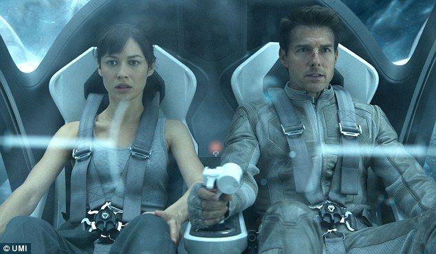 "Olga Kurylenko and Tom Cruise on the ""Oblivion"" movie"