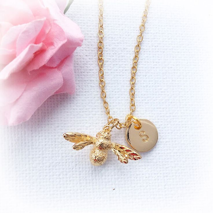 Personalised Gold Bumble Bee Necklace A beautiful initial charm necklace, featuring a gold bumble bee and a gold filled initial pendant, altogether creating a wonderful personalized necklace.Create a special meaning for someone special, u http://www.MightGet.com/january-2017-13/personalised-gold-bumble-bee-necklace.asp