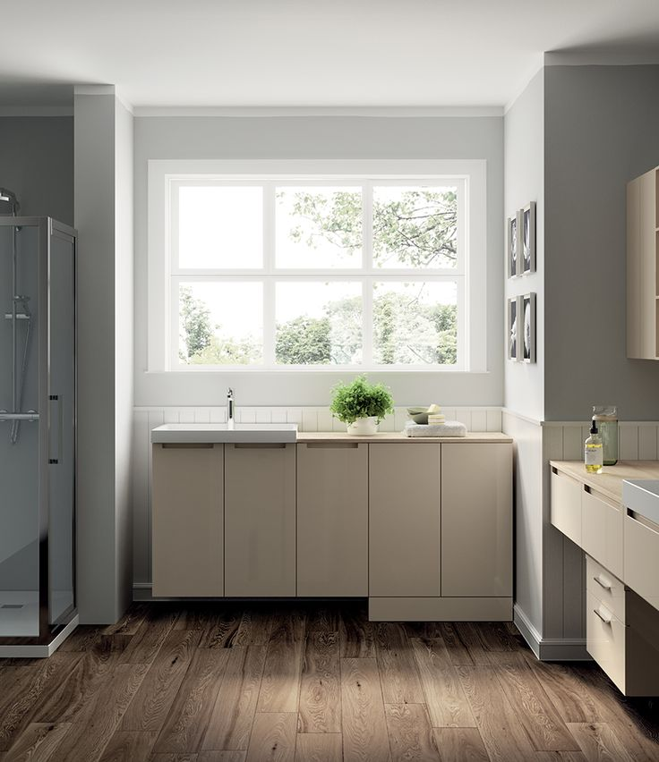 Scavolini's laundry room is distinguished by a rational elegance, aimed at creating the most suitable space for your needs.