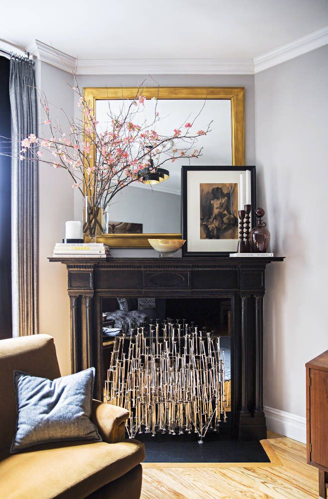 Small space? Take advantage of the mantel and make it the centerpiece next to your cozy furniture.