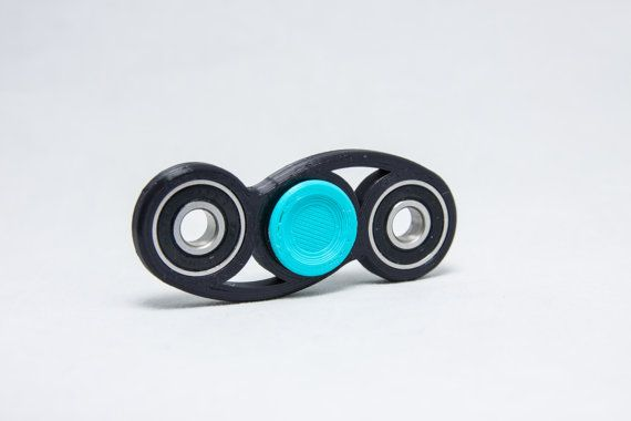 Ever catch yourself tapping your pen, or fiddling with a random object just to keep your hands busy? If so, this 3d printed spinner toy is for you and will keep your hands satisfied! This Dual-Twist bar spinner comes with ONE high quality Ceramic center bearing, TWO high quality steel 608 outer bearings, and TWO center bearing caps. One of the caps is contoured in order to provide better grip and the other cap is flat to give more versatility in holding positions.  The 3d printed body and…