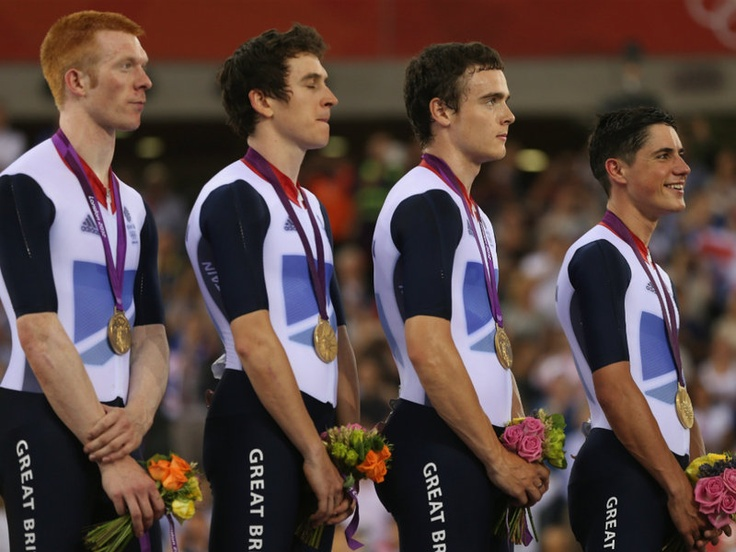 Clancy with team-mates Geraint Thomas, Steven Burke and Peter Kennaugh after winning gold in a new world record time in the track cycling men's team pursuit final