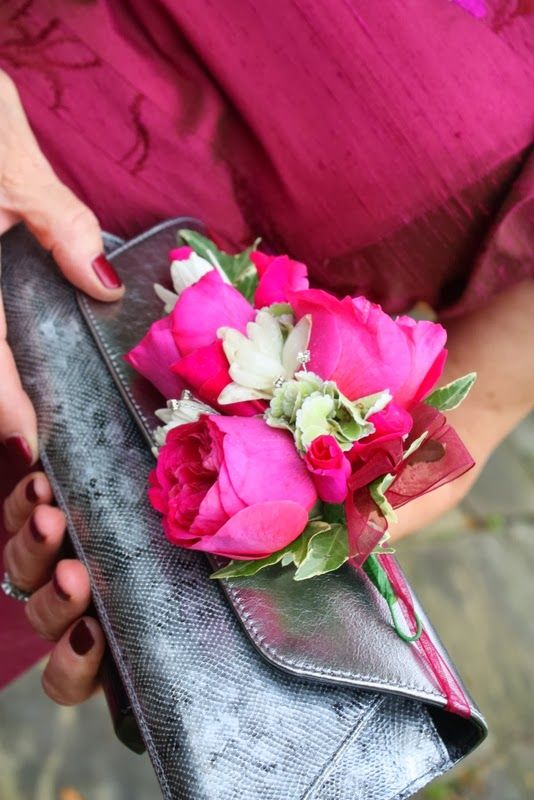 Fun idea for the mother of the bride or groom who wants flowers but also needs to hold a purse - a corsage around a clutch purse!