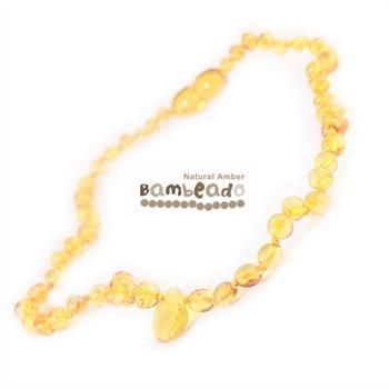 This Bambeado amber necklace comes in a Honey colour with a natural pendant centered to make a stylish difference. The amber necklace is approx 32-34cm in length. Bambeado amber is genuine baltic amber. Bambeado's are to be worn and not chewed. Each bead is individually knotted to help with safety. The Bambeado comes together with a plastic screw clasp.                 The Bambeado is designed to give way at the clasp or one bead will only break off if broken.