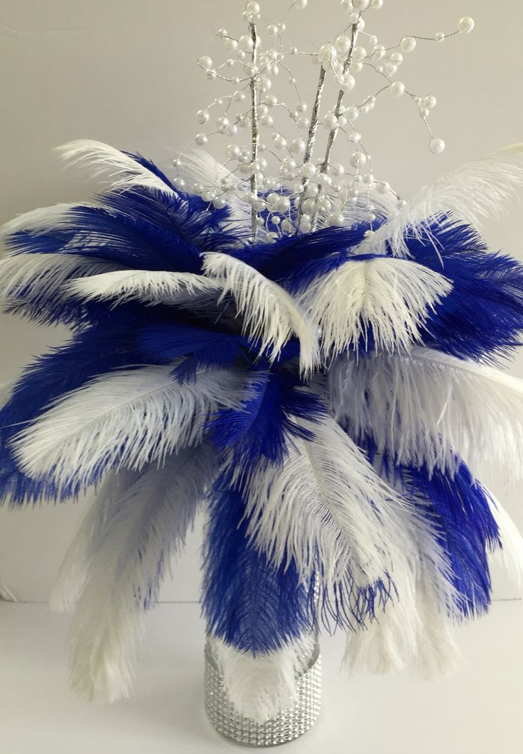 Royal blue and white feather centerpiece                                                                                                                                                      More