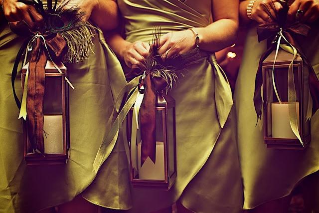 bridesmaids hold lanterns instead of flowers!