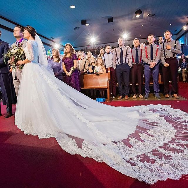 Jinger wore a hand-beaded lace gown with a 13-ft. train for her walk down the aisle on the arm of her father Jim Bob Duggar. #JeremyAndJingerSayIDo