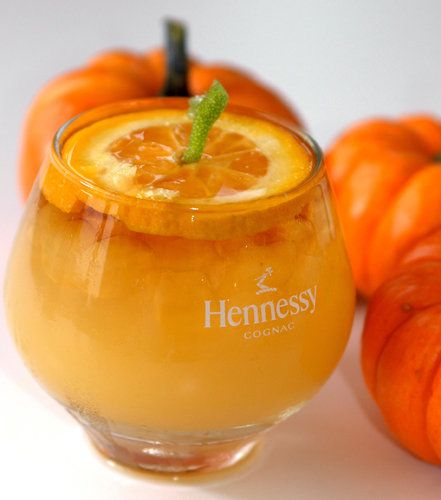 Jack-O-Lantern  adult beverage :1 oz Hennessy VSOP Cognac 1 1/2 oz orange juice, 1/2 oz Ginger ale, 1/2 oz Grand Marnier. Combine all ingredients in a shaker. Strain into a lowball glass over ice.  Float an orange wheel with a lime twist poked into the top.