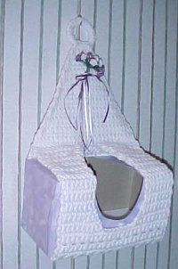 Hanging Tissue Cover- This is the perfect way to hide the ugly pattern of the your tissue box and put something you enjoy over it; plus, it's reusable!