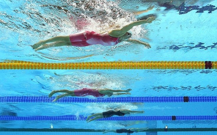 Rebecca Soni of the United States and Anastasia Chaun of Russia compete in heat 5 of  the Women's 200m Breaststroke