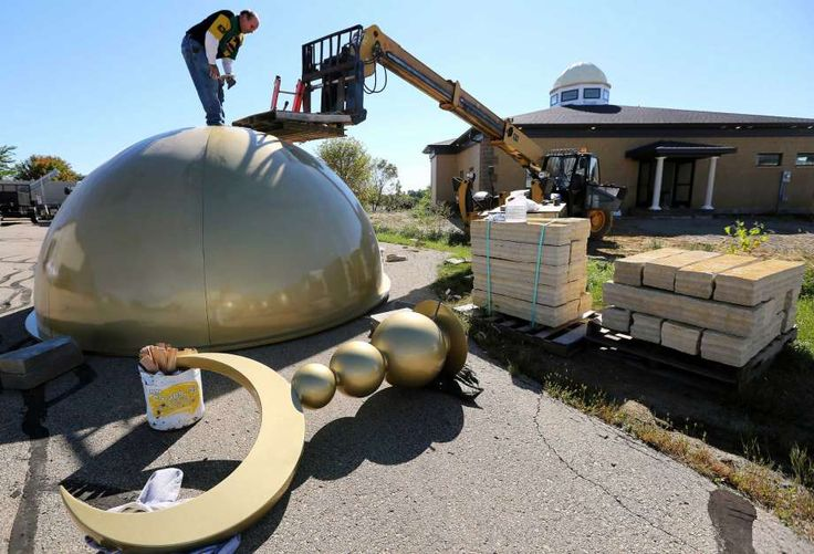 In this photo taken Thursday, Sept. 29, 2016, Gary Miller works on the dome of Tri-State Islamic Center before it is set atop the newly constructed building off of Radford Court in Dubuque, Iowa. It will be Dubuque's first mosque. (Dave Kettering/Telegraph Herald via AP) Photo: Dave Kettering, AP / Telegraph Herald